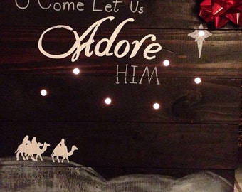 Adore Him plaque