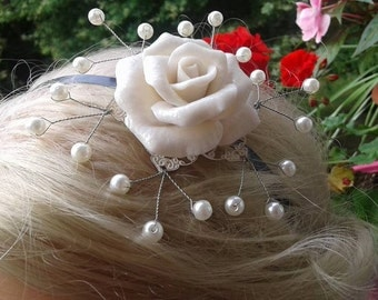 Pretty flower with pearls for beautiful hair