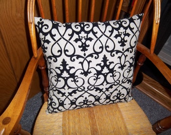 Off white with raised black design pillow