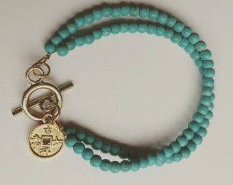 Beautiful double Bracelet by howlite beads and Golden lock with geluksmuntje