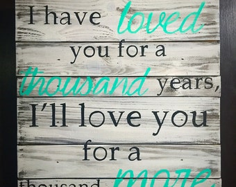 A Thousand Years Wood Sign
