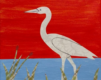 Heron - Mixed media acrylic paint and paper of a heron walking in a marsh against a red sky and blue water - 12 x 9 wrapped canvas