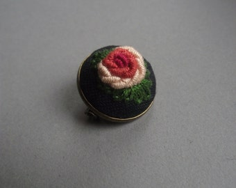Hand embroidered brooch with rose