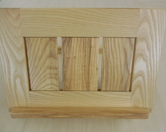 adjustable  tilt book stand.     custom made; one-of-a-kind.   In solid  ash.