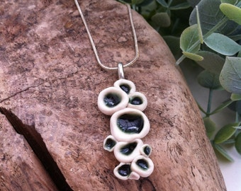 Ceramic pendant inspired by bubbles each filled with dark green glaze-handmade porcelain pendant