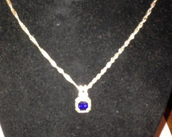 Beautiful blue stone sterling silver pendant with 24 inch sterling silver chain