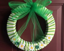 Door wreath in fun green stripe with silk flower embellishments and tulle bow ... proceeds to benefit liver cancer research