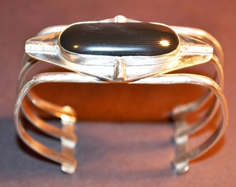 Womens cuff bracelet of Psilomilane and Silver