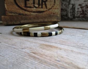 VINTAGE brass bangle bracelets set with white and black exterior (5 mm wide).
