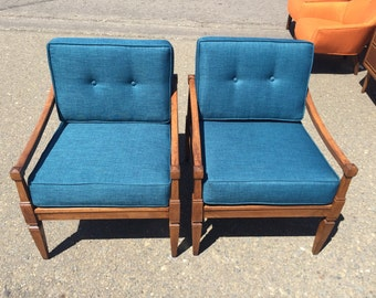 A pair of mid century lounge chairs