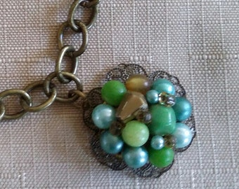 Upcycled Green and Gold Cluster Bead and Antique Bronze Charm Bracelet