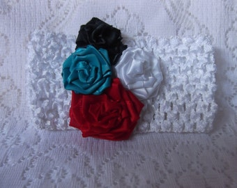 Child's Three inch decorated white crochet headband with silk flowers cluster