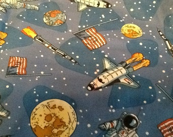 2-1/8 yards of Astronaut, space, rocket ship, earth fabric.