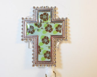Silver and Blue Cross with Green and Brown Flowers