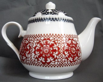 China teapot hand decorated with intricate lace design