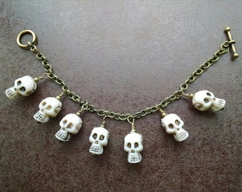 Antique Brass Plated Skull Charm Bracelet - Toggle Clasp