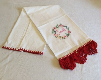 Tea towel with red crochet lace