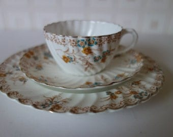 Victorian Trio; teacup, saucer and sideplate