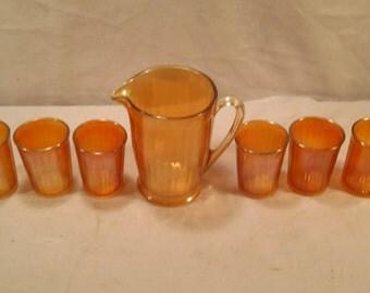 Vintage Carnival glass pitcher and glasses set