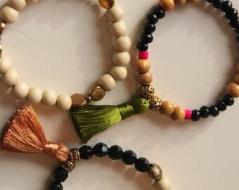 Steffi's two tassel stacked bracelets