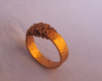 Ring with braided head