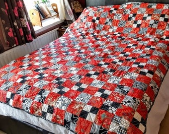 Red and black double bed quilt