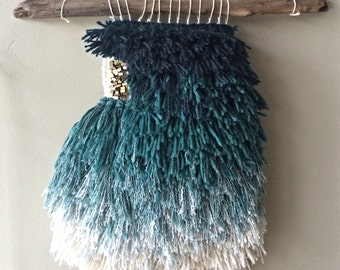 Teal ombré woven wall hanging with raw brass findings