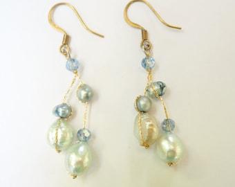 Blue freshwater pear dangle earring.