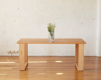 Handmade dining table, this was crafted using reclaimed timber taken from indoor grandstand seating dating to the 1950's.