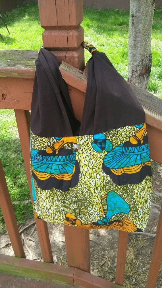 Unique bag made in Uganda. Green, blue, Orange and brown beach bag or purse. African print with beautiful detail on handle.