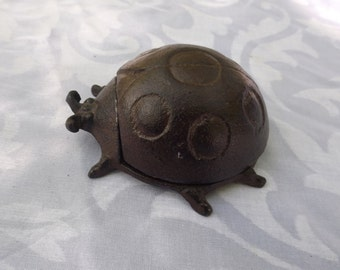 Adorable key holder cast iron ladybug hide-a-key for home or garden decor. Cast iron ladybug box collectible. New old stock. Gift
