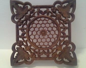 Wood carved trivet or stand
