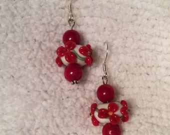 Fanciful red and white flower lampwork bead earrings with silver findings.