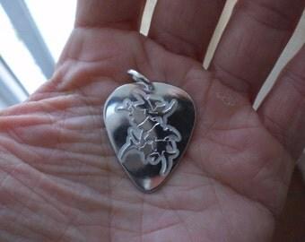 Sepultura pick silver pendant