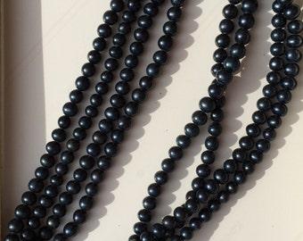 Black beaded multi strand necklace