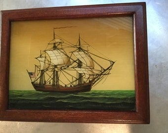 Fine wooden box with ship painting on the top
