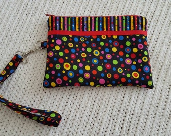 Bright and cheery wristlet.  Colors in red,blue,green,yellow,pink, and purple dots.