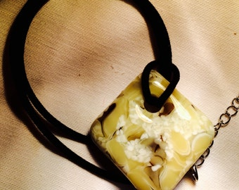Handmade glass pendant vanilla swirl with white/bronze/chocolate veins on black lanyard 12.00