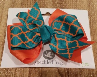 Orange and teal hair bow