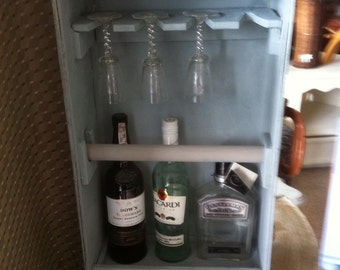Retro mini bar using vintage suitcase
