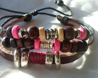 Very nice handmade leather and beaded bracelet! With pink accents!
