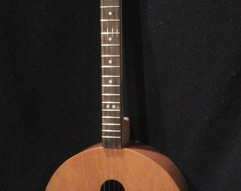 4 stringed round guitar