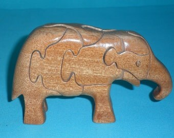 Elephant puzzle 3D in rainwood. Handmade in the heart of wood. Children game. Vintage toy. Educational game