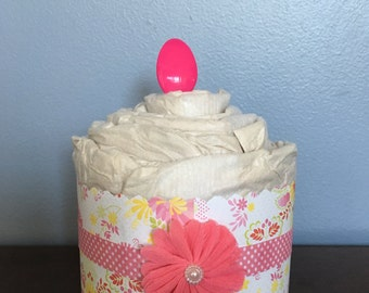 Pink flower diaper cupcake