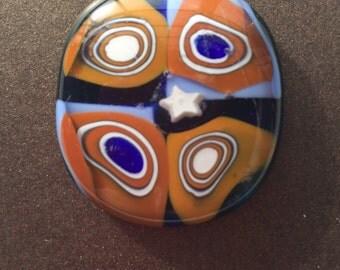 Fused glass pendant with star Blue/Orange.