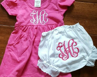 Monogrammed dress and bloomer outfit set.