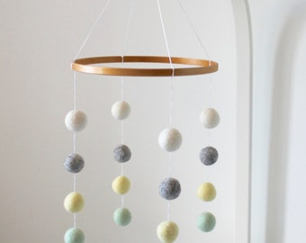 Felt ball cot mobile 'The Neutral one'