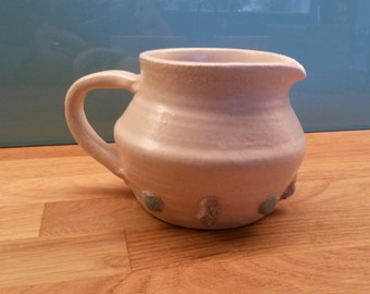 Stoneware coastal inspired hand thrown jug with motifs made from actual shells.