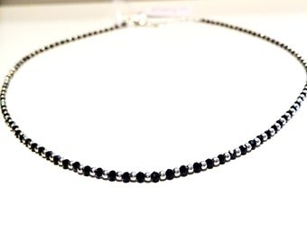 Silver necklace and black spinel faceted