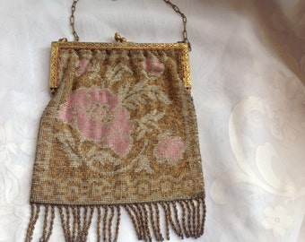 Vintage steel micro beaded purse with floral design and embossed frame